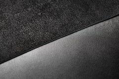 Dos pedazos de cuero negro Imagen de archivo libre de regalías