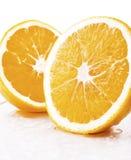 Dos pedazos de naranja Imagenes de archivo