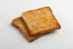 Dos pedazos de tostada en la tabla Imagen de archivo