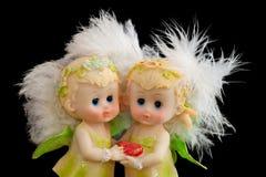 Dos pequeños ángeles encantadores Imagenes de archivo