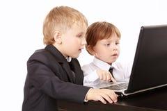 Dos pequeños hombres de negocios Imagen de archivo libre de regalías