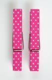 Dos pernos de ropa rosados con la diversión modelan la visión superior Fotografía de archivo libre de regalías