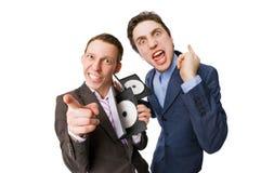 Dos personas jovenes que ofrecen DVDs para la venta Imagen de archivo