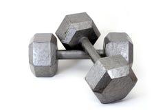 Dos pesas de gimnasia cruzadas Foto de archivo libre de regalías