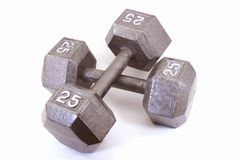 Dos pesas de gimnasia cruzadas Fotos de archivo libres de regalías