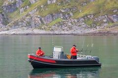 Dos pescados de la captura de los pescadores de un barco Imagen de archivo libre de regalías