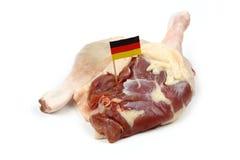 Dos piernas del pato con la bandera alemana Imágenes de archivo libres de regalías