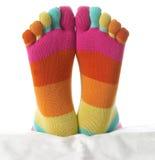 Dos pies en medias Fotografía de archivo