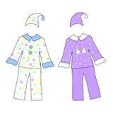 Dos pijamas con las estrellas aisladas en blanco Imagenes de archivo