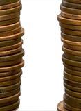 Dos pilas de las monedas de cobre   Fotos de archivo libres de regalías