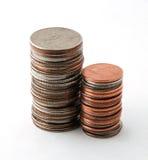 Dos pilas de monedas Imagen de archivo libre de regalías