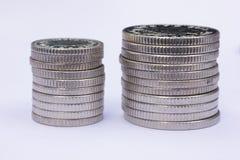 Dos pilas de monedas de plata Imágenes de archivo libres de regalías