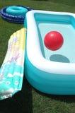 Dos piscinas y una bola Fotografía de archivo libre de regalías