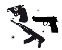 Dos pistolas y máquinas Fotos de archivo libres de regalías