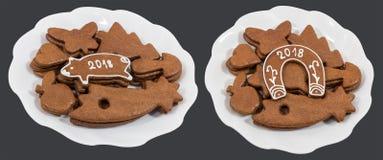 Dos placas blancas con los panes de jengibre de la Navidad y del Año Nuevo Imagen de archivo