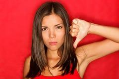 Dos polegares mulher infeliz para baixo Foto de Stock Royalty Free
