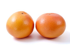 Dos pomelos anaranjados Imagen de archivo libre de regalías