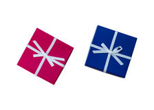 Dos presentes, con rojo, cinta azul en el fondo blanco Fotografía de archivo libre de regalías