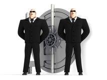Dos protectores protegen una caja fuerte Imagen de archivo