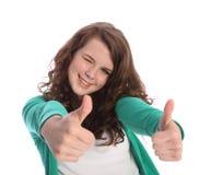 Dos pulgares para arriba para el éxito por la muchacha sonriente del adolescente Imagen de archivo libre de regalías