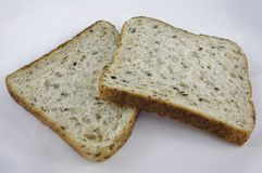 Dos rebanadas de pan integral. Fotografía de archivo