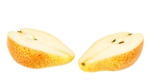 Dos rebanadas rojo-amarillas de pera Fotos de archivo