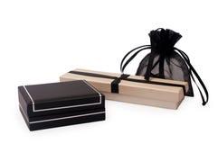 Dos rectángulos de regalo y un saco del regalo Imágenes de archivo libres de regalías