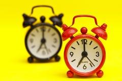 Dos relojes de alarma Imágenes de archivo libres de regalías