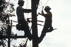 Dos reparadores del teléfono Imagenes de archivo