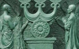 Dos rezos; fragmento de la estatua de Buddah; Japón Foto de archivo libre de regalías