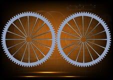 Dos ruedas dentadas en un amarillo Fotografía de archivo libre de regalías