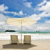 Dos sillas en la playa Fotos de archivo libres de regalías