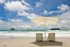 Dos sillas en la playa Imágenes de archivo libres de regalías