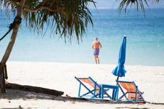 Dos sillas en la playa Imagen de archivo libre de regalías