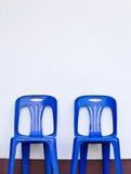 Dos sillas plásticas Imagen de archivo libre de regalías