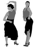 Dos siluetas de bailarín de sexo femenino del flamenco Imagen de archivo libre de regalías