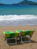 Dos sunbeds en la playa Imagen de archivo libre de regalías