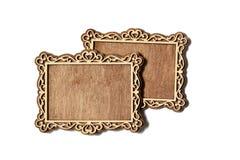Dos tallaron marcos de madera en un fondo blanco Fotos de archivo libres de regalías