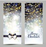 Dos tarjetas de felicitación de la Navidad con el arco y las guirnaldas Imagen de archivo