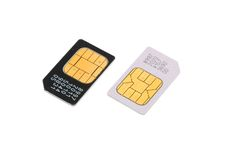 Dos tarjetas de SIM para los teléfonos móviles aislados Fotografía de archivo libre de regalías