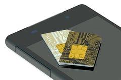 Dos tarjetas y teléfono de SIM Imagen de archivo libre de regalías