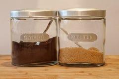 Dos tarros de café y de azúcar Fotografía de archivo libre de regalías
