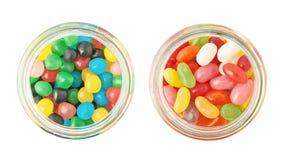 Dos tarros por completo de diferentes tipos de caramelos Imagen de archivo
