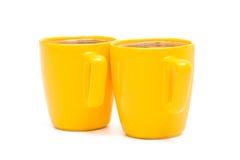 Dos tazas amarillas Fotos de archivo