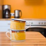 Dos tazas anaranjadas Foto de archivo