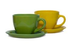 Dos tazas con los platillos. Imagen de archivo libre de regalías