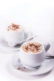 Dos tazas de café con crema azotada Fotografía de archivo