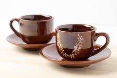 Dos tazas de café con los platillos Imagen de archivo libre de regalías