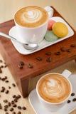 Dos tazas de café del capuchino Foto de archivo