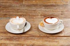 Dos tazas de café del latte Imagen de archivo libre de regalías